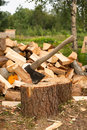 Axe In A Log Royalty Free Stock Image - 75151436