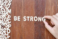 Word Be Strong  Made With Block Wooden Letters Stock Photos - 75173413