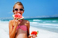 Child Eating Watermelon On The Beach Stock Images - 75181644