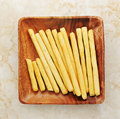 Bread Sticks In A Wooden Bowl Stock Image - 75186791
