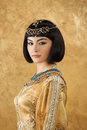 Beautiful Woman Like Egyptian Queen Cleopatra With Serius Face On Golden Background Royalty Free Stock Images - 75189839