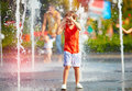 Excited Boy Having Fun Between Water Jets, In Fountain. Summer In The City Stock Photo - 75216790