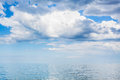 Clouds In Blue Sky Over Calm Water Of Azov Sea Royalty Free Stock Images - 75239059