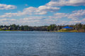 Peaceful Lake Murray Water Landscape Yacht Building Blue Roof Sun Stock Photos - 75263063