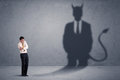 Business Man Looking At His Own Devil Demon Shadow Concept Royalty Free Stock Image - 75265806
