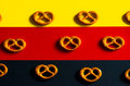 Many Small Pretzels  On A Background Of The German Flag Colors Royalty Free Stock Photos - 75278588