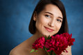 Close Up Portrait Of Tender Young Girl With Red Flowers Over Blue Background Royalty Free Stock Photos - 75303488