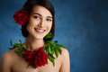 Close Up Portrait Of Tender Young Girl With Red Flowers Over Blue Background Stock Photo - 75303500