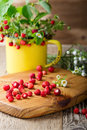 Wild Strawberries In Yellow Mug  In Retro Style Royalty Free Stock Images - 75311739