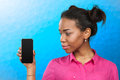 Woman Showing A Mobile Phone Royalty Free Stock Photos - 75323418