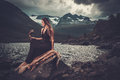 Nordic Goddess In Ritual Garment With Hawk Near Wild Mountain Lake In Innerdalen Valley. Royalty Free Stock Photos - 75330358
