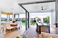 Modern Dining Room Attached To Outside Patio Area Stock Photo - 75331460