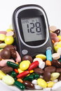 Glucometer With Result Sugar Level And Heap Of Medical Pills And Capsules, Diabetes, Health Care Concept Stock Photos - 75332293