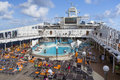 Passengers Enjoy A Day At Sea On The Top Deck Of Cruise Ship Stock Photos - 75335883