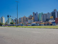 FLORIANOPOLIS, BRAZIL - MAY 08, 2016: Lot Of Cars Parked In An Empty Aveneu With The Buildings Skyline As Background Royalty Free Stock Photography - 75339437