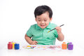 Portrait Of Cheerful Asian Boy Painting Using Watercolors Stock Image - 75342681