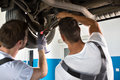 Mechanics Working Together On Car Repair Royalty Free Stock Photos - 75369358