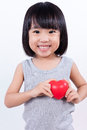 Asian Little Chinese Girl Holding Red Heart Royalty Free Stock Image - 75383906