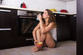 Woman Having A Breakfast At Her Kitchen Stock Photo - 75390440