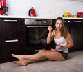 Woman Having A Breakfast At Her Kitchen Royalty Free Stock Image - 75390466