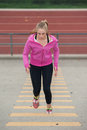 Warming Up In Pink Jacket With Small Steps Royalty Free Stock Images - 75394889