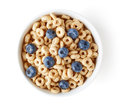 Bowl Of Whole Grain Cheerios Cereal With Blueberries Isolated On Royalty Free Stock Image - 75407126