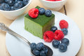 Green Tea Matcha Mousse Cake With Berries Royalty Free Stock Photo - 75444175