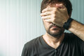 Casual Adult Male Covering Face And Eyes With Hand Royalty Free Stock Image - 75446966