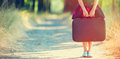 Girl With Suitcase Stock Images - 75467584
