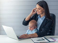 Business Lady With Her Baby Royalty Free Stock Photography - 75477277