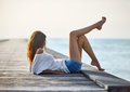 Sexy Beautiful Woman Relaxing On Pier With Sea View Royalty Free Stock Image - 75479116