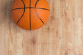 Close Up Of Basketball Ball On Wooden Floor Royalty Free Stock Photography - 75492627