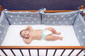 Infant Baby Laying In Decorated Cot Royalty Free Stock Photo - 75500385