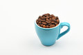 Blue Espresso Cup Full Of Coffee Beans Over White Stock Photography - 75532702