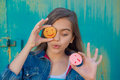 Cheerful Girl With A Round Pastry Royalty Free Stock Image - 75536656