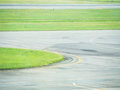 The Stripes And Curves Of Taxiway And Green Grass At The Airport Stock Image - 75586981