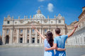 Happy Couple Tourists Looking At St. Peter S Basilica Church In Vatican City, Rome, Italy. The St. Peter S Basilica Royalty Free Stock Image - 75602206
