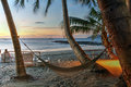 Hammock On Tropical Beach At Sunset Stock Images - 75646024