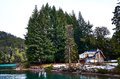 Small Cottage Next To Some Tall Pines Royalty Free Stock Photo - 75690565
