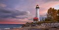 Sunset At The Crisp Point Lighthouse Royalty Free Stock Photos - 75696278