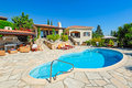 Private Swimming Pool And Patio Area Stock Images - 75714734