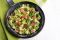 Scrambled Eggs With Green Onions And Prosciutto In A Black Iron Royalty Free Stock Photos - 75722338