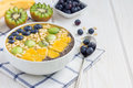 Breakfast Smoothie Bowl Topped With Berries, Fruits, Nuts And Seeds Royalty Free Stock Images - 75734839