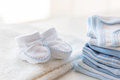 Close Up Of Baby Boys Clothes For Newborn On Table Royalty Free Stock Photos - 75798768