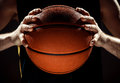 Silhouette View Of A Basketball Player Holding Basket Ball On Black Background Stock Image - 75888431