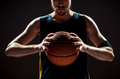 Silhouette View Of A Basketball Player Holding Basket Ball On Black Background Stock Image - 75888471