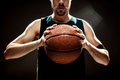 Silhouette View Of A Basketball Player Holding Basket Ball On Black Background Stock Images - 75888654