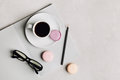 Morning Cup Of Coffee, Empty Notebook, Pencil, Glasses And Cake Macaron On Gray Desk Overhead View. Beautiful Breakfast. Flat Lay. Stock Image - 75896021