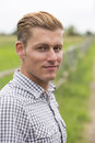 Portrait Of Blond Man In Nature Stock Image - 75896341