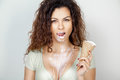 Young Beautiful Woman With Curly Hair Eats Icecream Royalty Free Stock Photography - 75924647